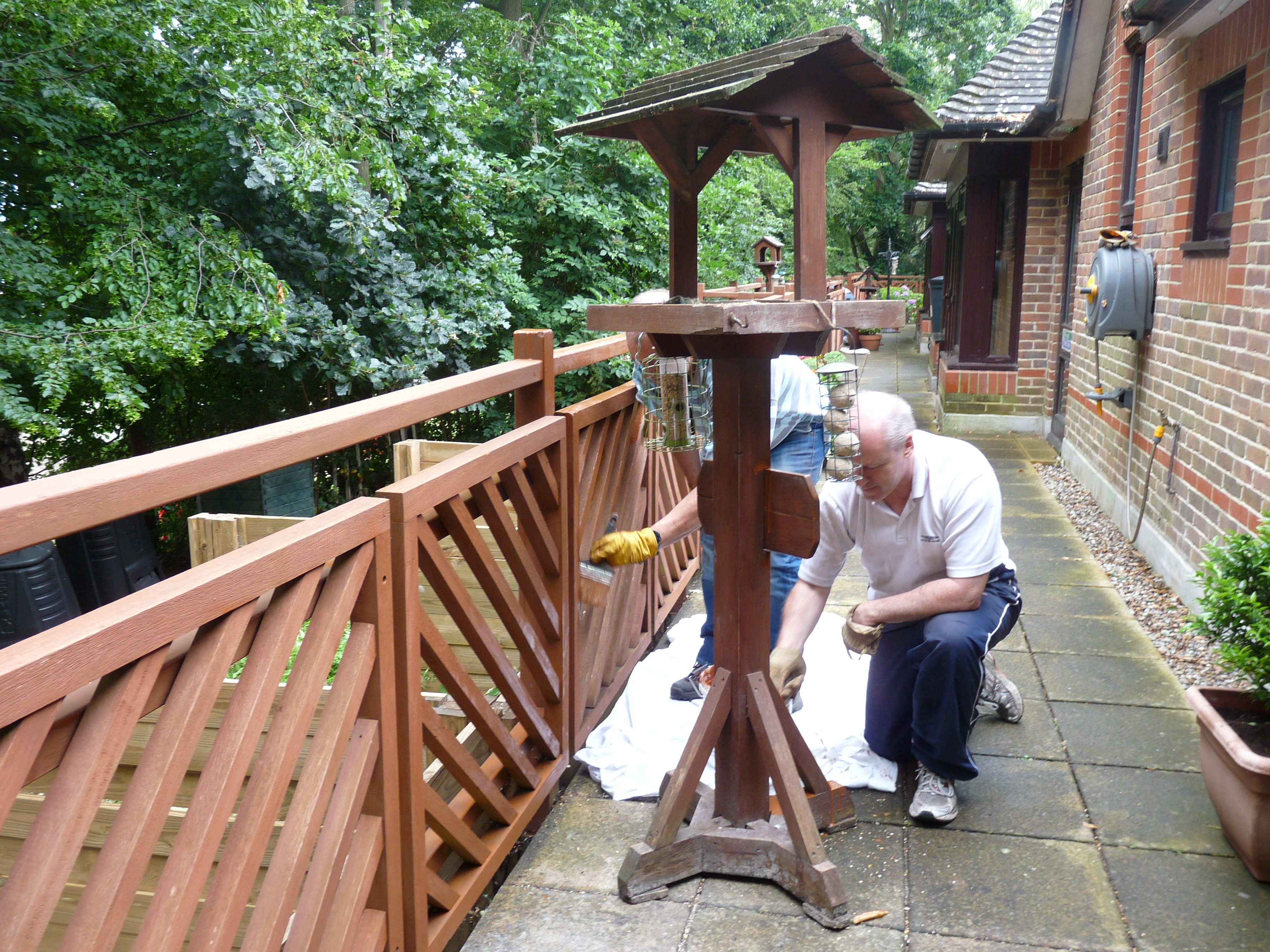 The team from Lloyds Maidstone painting the railings outside our patient rooms