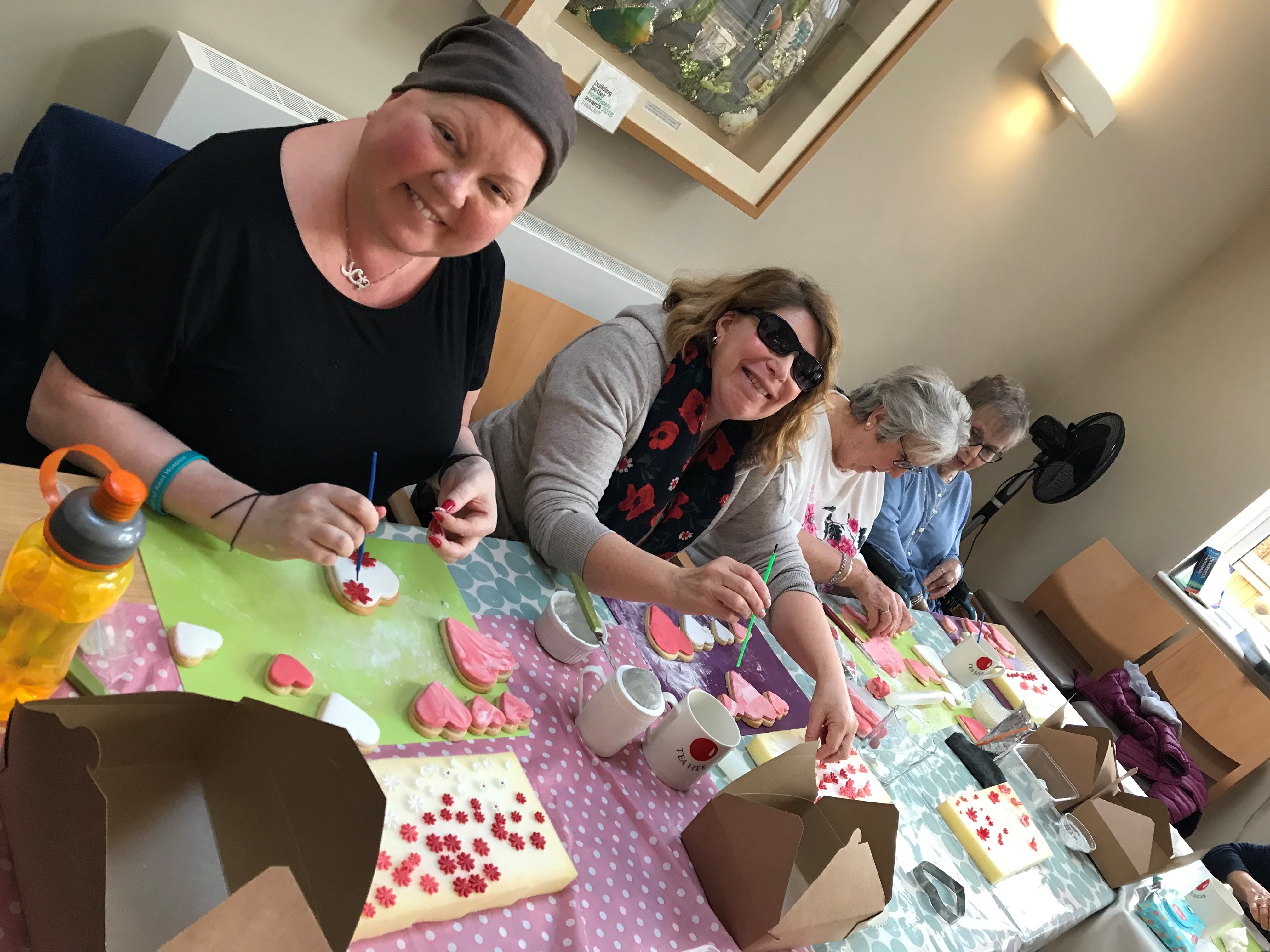 Paula Smallwood enjoying a biscuit decorating class, part of the Living Well programme.