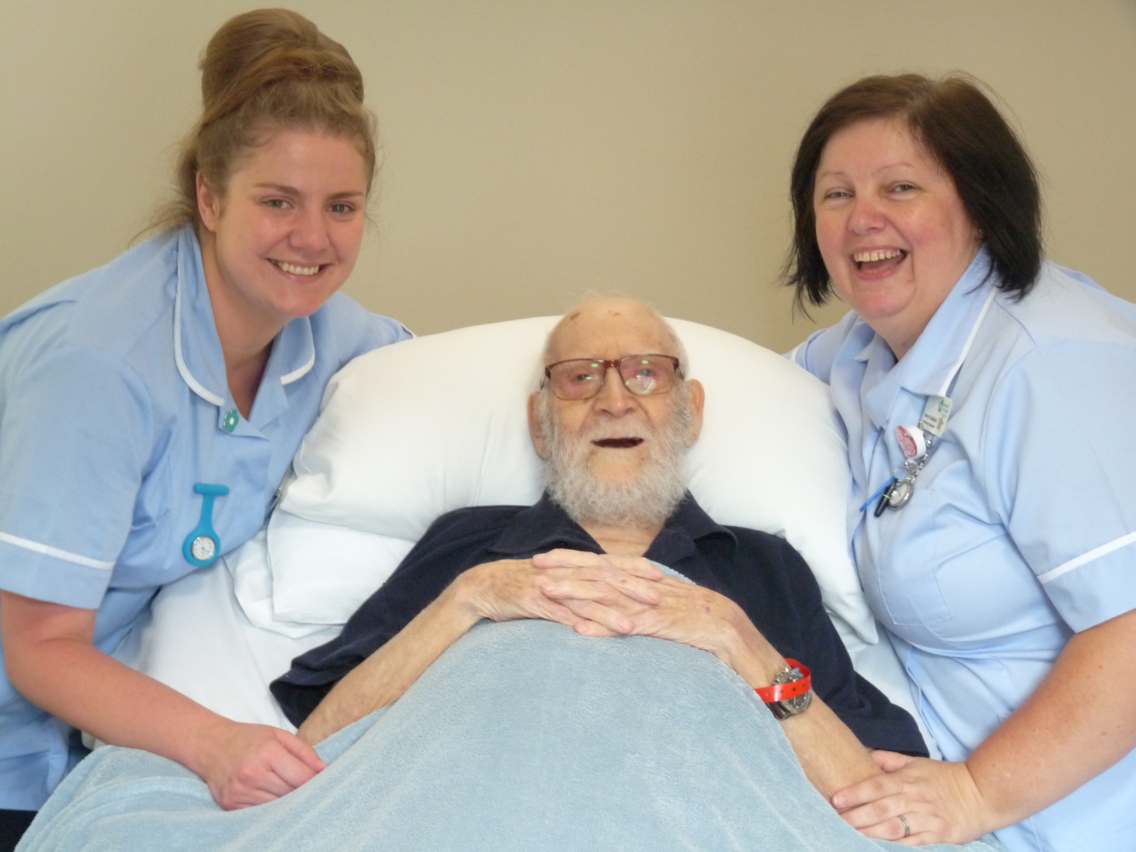 Two nurses smiling with a Hospice patient